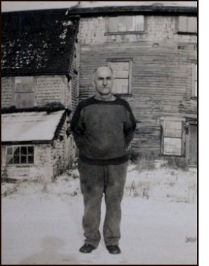 Blair Leblanc in late 1940s standing in front of the old abandoned tanning shop
