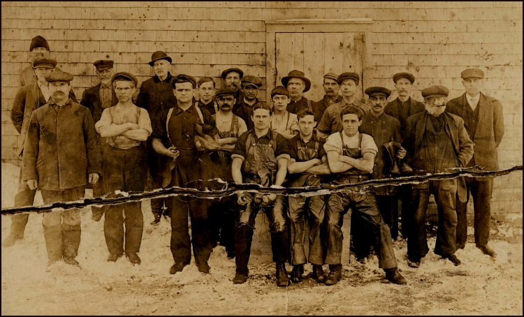 Workers at the A.E. Wry Standard Manufacturing (circa 1910). Note William Bourque (third from left) with moccasin in left hand and an awl in his right