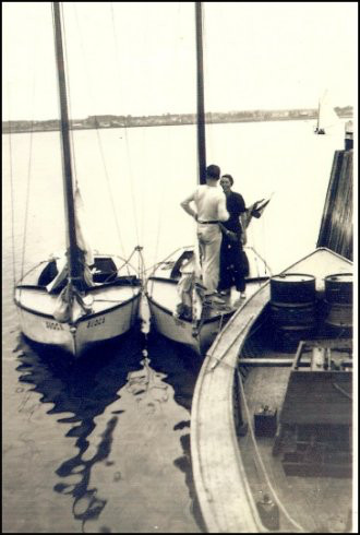 Charles Fawcett and Bunny Black standing on one of the Fawcett built yachts at the Shediac Bay Yacht Club August 30, 1936