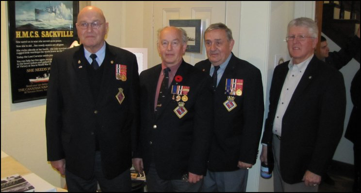 left to right: Don Mackey, Cdr. Wendall Brown, Ray Soucie from the Canadian Naval Memorial Trust (HMCS Sackville) in Halifax with Al Smith at the November 11, 2010, reception at the HMCS Sackville exhibit