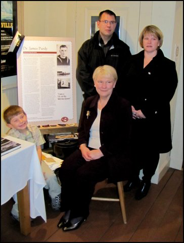 Jim's wife Susan (sitting) with their son Tim Purdy, daughter Charlotte Purdy Weir and grandson Benjamin Weir