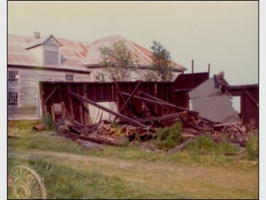 The original Blacksmith Shop at the Campbell Carriage Factory burning down (note the back-ell of the factory which had seriously deteriorated since the photo was taken and re-built by the Trust).