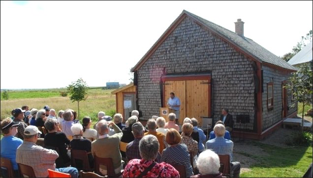Geoff Martin with MLA Mike Olscamp officially opening the renovated blacksmith shop  to the public on September 18