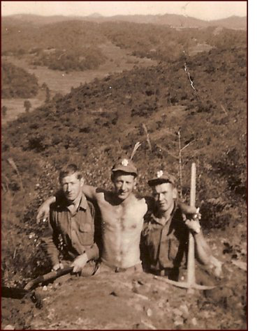Stanley Ward (at right) and chums digging in Korea 1952. Note the rugged terrain. (C. MacKinnon collection)