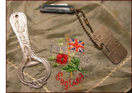There were few personal effects returned to the family: an ornate bottle opener, a dainty handkerchief embroidered From Old England and his dog-tags with a pen knife attached. (C. MacKinnon collection)