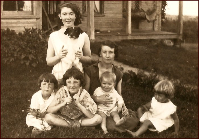 At the MacKinnon home in Frosty Hollow. Kneeling (behind): Myrtle (MacKinnon) Brown. Left to right (in front): Helen MacKinnon, Doris MacKinnon, Stella (MacKinnon) Ward (holding Stanley) and Ruth (Ward) Bulmer, c.1933. Stanley's mother, Stella, died of tuberculosis on 22 December 1936. (C. MacKinnon collection)