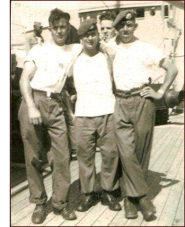 """On the ship to Korea. Left to right (front row), Stanley (Buddy) Ward, Robert (Bob) Turner and Harold Mitton. Robert was author of """"Moments that forever haunt me"""". (C. MacKinnon collection)"""