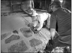 Field stone was carefully set into concrete floor before it solidified