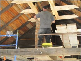 Darrel lays up the chimney until it reaches its new supporting beams