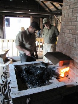 Aug 12th, Paul Bogaard helps start up the first fire in the new forge