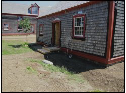 Although siding still needs to be replaced, filling round with gravel cleans up this summer's job