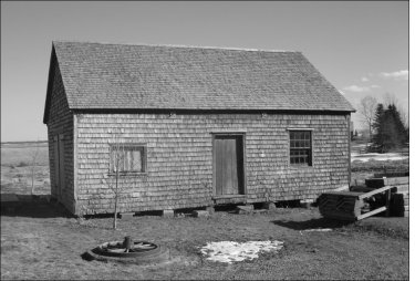 black and white photograph of blacksmith's shop