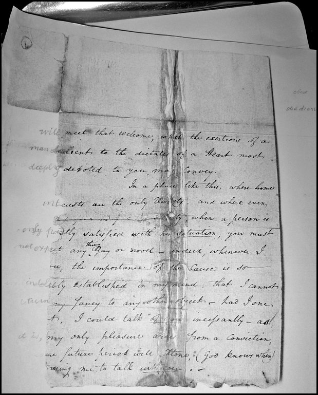 hand-written letter, heavily damaged