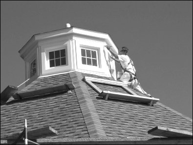 Putting a fresh coat of paint on the new cupola