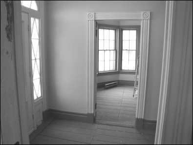 Original floors and woodwork restored in front entry  and parlour
