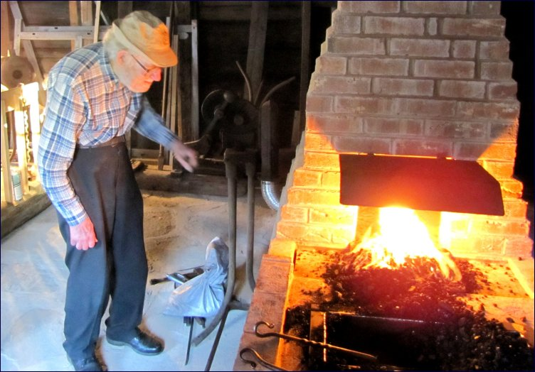 Daniel inspects the new working forge in the Blacksmith Shop of the Campbell Carriage Factory Museum