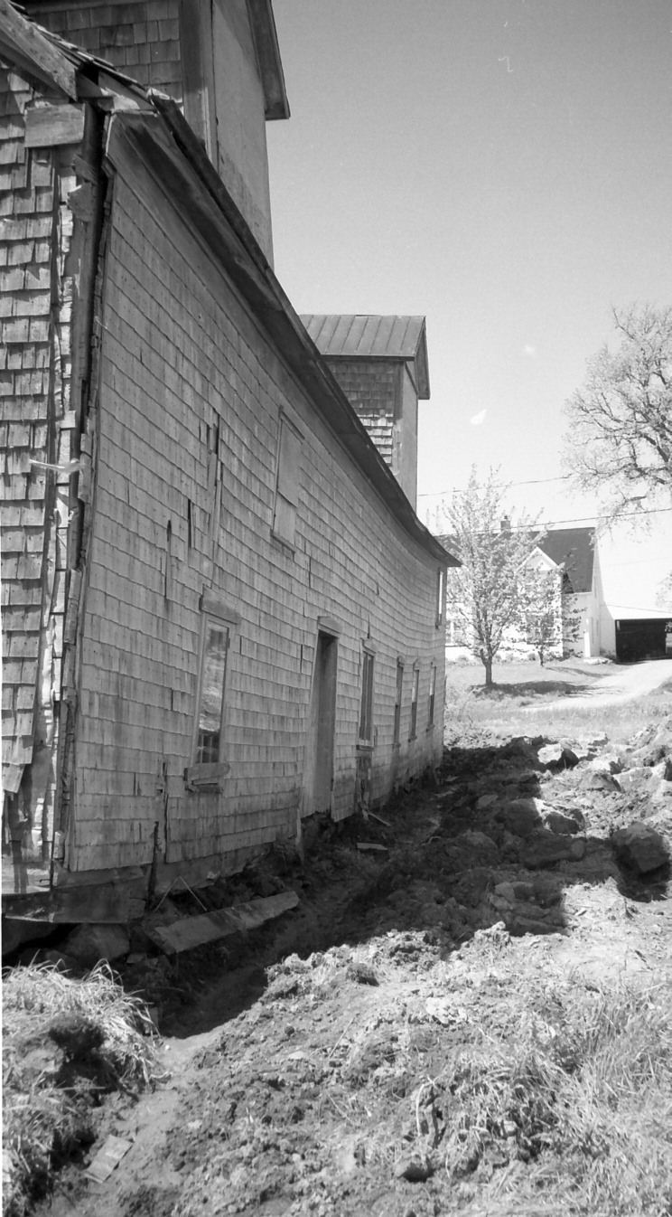 Photo of drainage ditch along backside of Carriage Factory