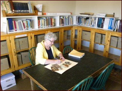 Woman reading in the Alec R. Purdy Tantramar History and Genealogy Research Centre