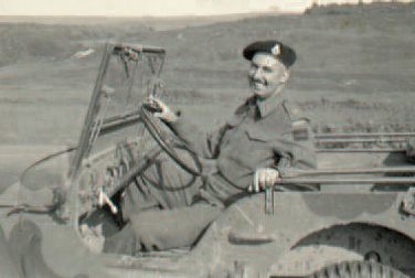 Photo of Bob Ross in a military jeep