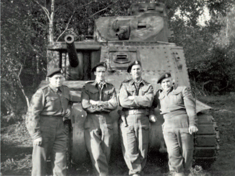 Canadian soldiers pose in front of tank