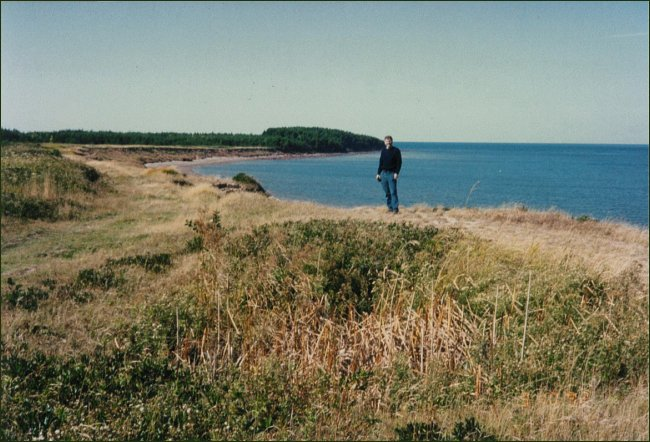 """Alan McIver standing on the edge of the """"Money Pit"""" at Cape Jourimain"""