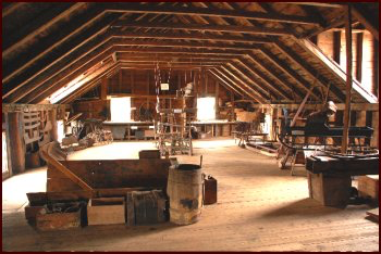 """The upper floor housed the Storage, Assembly and Paint areas. Exhibits on this level include an """"exploded"""" display illustrating how the numerous component parts were assembled to make a finished carriage."""