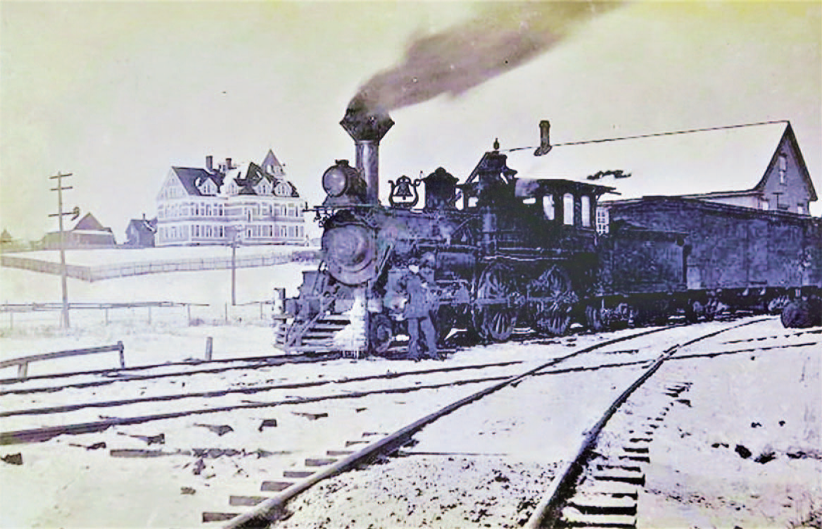 Locomotive with old Sackville High School in background circa 1910